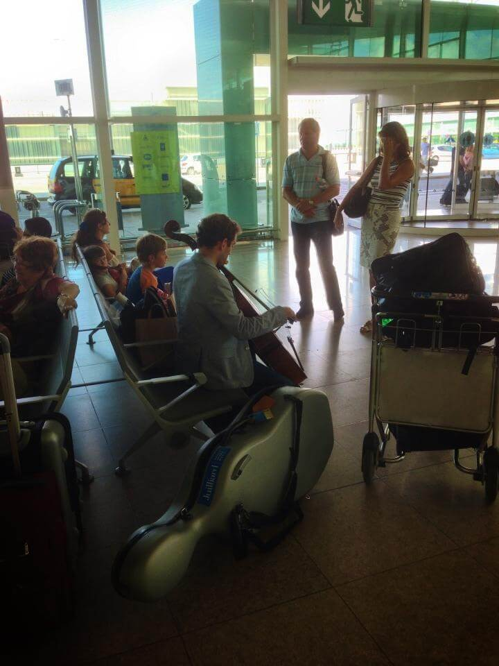Barcelona Airport playing cello Thomas Mesa